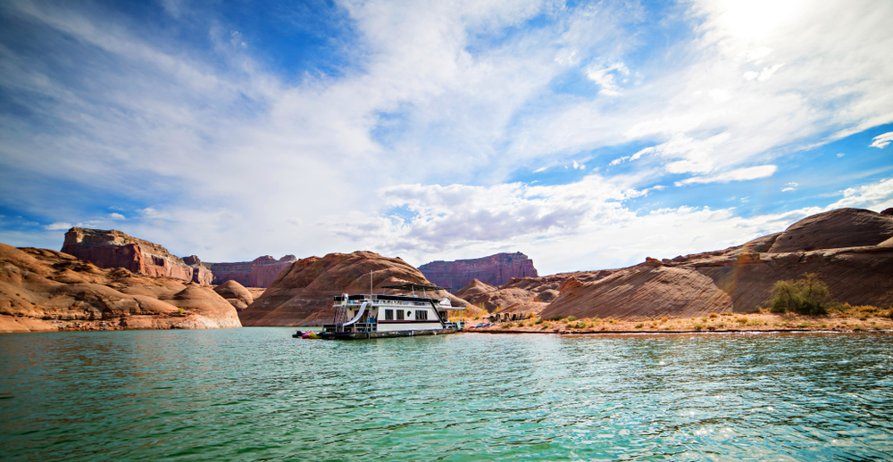scenic view of lake powell with a boat with arizona insurance