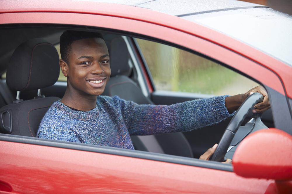 african american Teenage Boy Driver Sitting In Car
